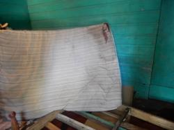 Blood stains are visible on the mattress.