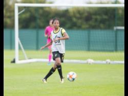 Chantel Hudson-Marks passes the ball during a Reggae Girlz training session at the Centre de Vie Raymond Kopa in Reims, France, on Monday.