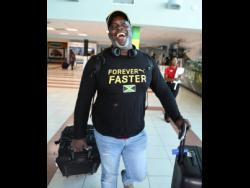 Throws coach Julian Robinson  arrived  at the Norman Manley International Airport from the IAAF World Championships held in Doha, Qatar, on October 7, 2019.
