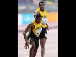 Gladstone Taylor Akeem Bloomfield (right) hands off the baton to Nathon Allen in the semi-final of the men's 4x400m at the recently concluded World Championships in Doha, Qatar.