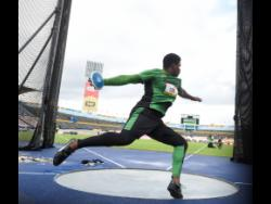 Kai Chang of Calabar High School competes in the Class One boys' discus throw at the ISSA/GraceKennedy Boys and Girls' Athletics Championships on March 28, 2019.
