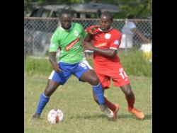 In this January 2018 file photo, Montego Bay United's Dino Williams (left) shields Boys' Town's Ricardo Dennis from the ball during a Red Stripe Premier League game at the Barbican field that season.