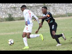 Cavalier's Chevone Marsh (right) challenges Portmore United's Lamar Walker for the ball during a Red Stripe Premier League match on February 10, 2019.
