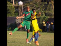 Humble Lion's Andre Clennon (left) jumps high for a ball with Vere United's Kenroy Lumsden during their recent Red Stripe Premier League match on December 15, 2019.