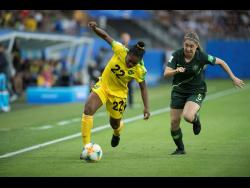 Jamaica's Mireya Grey dribbles away from Australia's Karly Roestbakken during a FIFA Women's World Cup first-round match on June 18, 2019.