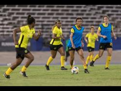 Reggae Girl Christina Chang (second right) looks for a pass during a training session at the National Stadium on Monday, May 13, 2019 as Jamaica's senior women's team prepared for their debut at the FIFA Women's World Cup that summer.
