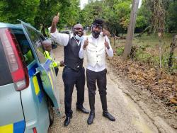 Richie Stephens (left) and  Beenie Man at the funeral in St Elizabeth on Sunday for Lilieth Sewell, Beenie Man's mother.