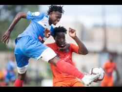 Tivoli Gardens FC's Jabeur Johnson (right) tries to prevent Portmore United's Chavany Willis during a National Premier League match at the Spanish Town Prison Oval on Sunday, March 1.