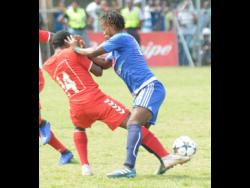 File Kemar Beckford (right) of Mount Pleasant shoves Kemar Flemmings (left) off the ball during a Premier League match on March 31, 2019.