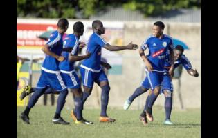 Suelae McCalla (second right) of Mount Pleasant FA celebrates a goal scored against Waterhouse FC, with teammates at the Drewsland Stadium on Thursday, January 10.
