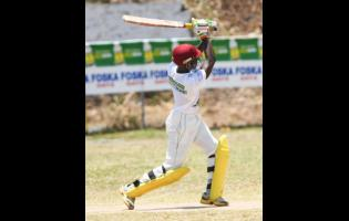 Leronne Tyrell of Rio United plays one of many impeccable shots on his way to a century against St Margaret's Bay in the SDC Community T20 cricket competition in Buff Bay, Portland, yesterday.