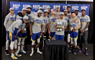 The Golden State Warriors players pose with the Western Conference Championship trophy after Game Four of the NBA basketball play-offs Western Conference finals against the Portland Trail Blazers on Monday.