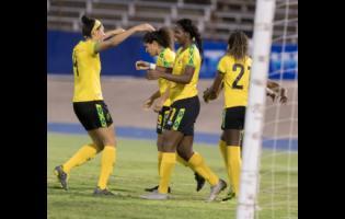 Reggae Girl Khadija Shaw (third from left) celebrates her second goal scored, with her teammates, during Jamaica's international friendly match against Panama at the National Stadium on Sunday. The Reggae Girlz won 3-1.