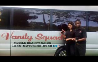 The Vanity Sqaud team members: Kenroy Davis (right) and Sasha Dunkley pose in front of the unit.