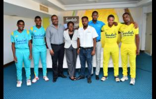 From left: Western Heat players Matthew Bell, and Mathew Comerie, Jamaica Cricket Association (JCA) Chief Executive Officer Courtney Francis, JCA Board Director Pauline White-Anderson, Sandals Resorts Public Relations Manager – Sponsorships Crissano Dalley, Corporate Sales Manager at Rainforest Seafoods Richard Coleman and Northern Lights players Junior Coleman and Romaine Bennett at the launch of the 2019 Sandals Under-19 Cricket Championships at Sabina Park, in Kingston, on Tuesday.