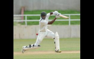 In this file photo from Monday, December 8, 2014, David Bernard Jr plays a shot for four runs against the Leeward Islands Hurricanes on the final day of the Cricket West Indies Professional Cricket League Regional 4-Day Tournament at Sabina Park in Kingston.