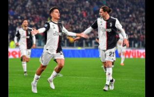 Juventus' Paulo Dybala jubilates after scoring the goal (1-0) during the Italian Serie A match Juventus FC vs AC Milan at Allianz stadium in Turin, Italy, yesterday.