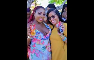 Friends share a sweet moment at Riviera Anniversary, held at Sugarman's Beach, Hellshire, recently.