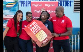 "It was a super happy moment for Digicel customer, Andrene Holness (second right), when she officially received her ""Free Mobile Service for Life"" prize from Digicel Public Relations and Communications Manager, Elon Parkinson (right), Brand Marketing Manager, Michaela Francis (second left), and Digital Media Executive, Kadeen Brown."