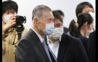 Tokyo 2020 Organising Committee President Yoshiro Mori arrives for the first meeting of  the 'Tokyo 2020 New Launch Task Force' in Tokyo  yesterday, March 26, 2020, days after the unprecedented postponement was announced due to the spreading coronavirus.