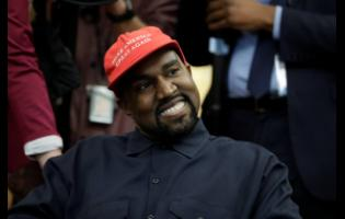 Rapper Kanye West wears a Make America Great Again hat during a meeting with President Donald Trump in the Oval Office of the White House in Washington in October 2018.