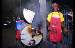 Rueben Hickinson, a pan chicken vendor along Red Hills Road in Kingston.