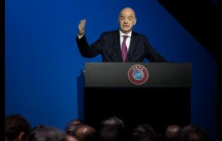 In this Tuesday, March 3, 2020 file photo, FIFA President Gianni Infantino addresses a meeting of European leaders at the congress of the UEFA governing body in Amsterdam's Beurs van Berlage, Netherlands.