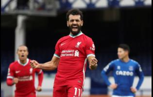 In this October 17, 2020 file photo, Liverpool's Mohamed Salah celebrates scoring his side's second goal during the English Premier League match against Everton at Goodison Park stadium in Liverpool, England.