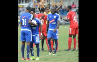 File Mount Pleasant's Fancios Swaby and Cardel Benbow converse after their team was awarded a penalty against UWI FC in a quarter-final encounter in the National Premier League on March 31, 2019.