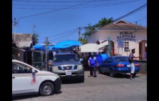 Motorists are parked outside a section of the Lucea Market in Hanover.