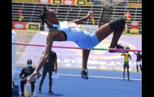 Edwin Allen High School's Asia McKay on her way to victory in the Class Four Girls high jump in the ISSA/GraceKennedy Boys and Girls' Athletics Championships at the National Stadium last Friday.