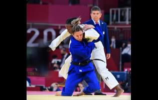 Jamaica's Ebony Drysdale-Daley competes against Portugal's Barbara Timo during the women's 70kg elimination round of judo at the Tokyo 2020 Olympics at Nippon Budokan yesterday. Gladstone Taylor Photo