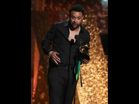 Shaggy accepts the award for best reggae album for 44/876 at the 61st annual Grammy Awards in Los Angeles. (Photo by Matt Sayles/Invision/AP)