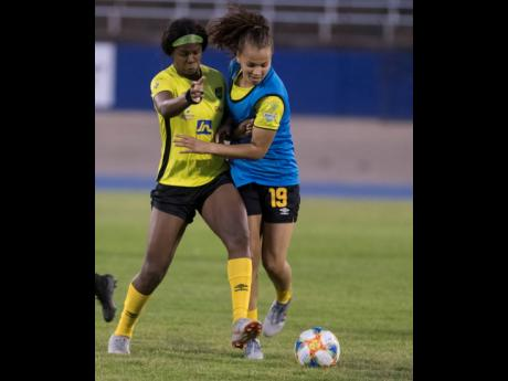 Khadija Shaw (left) and Toriana Patterson in a tussle for the ball.