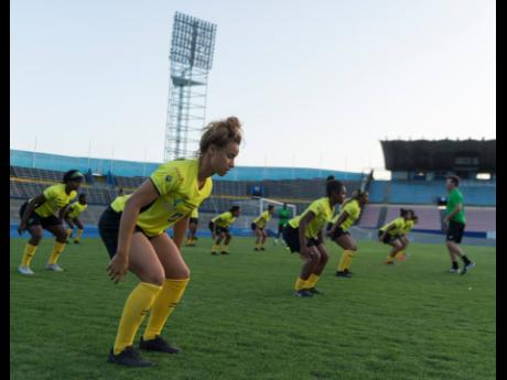 Ashleigh Shim (foreground) warms up with teammates during the session.