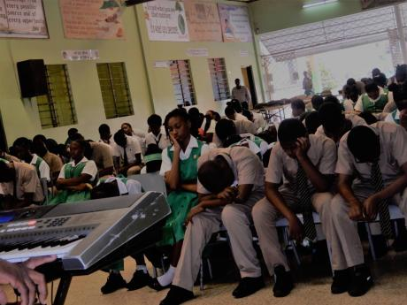 May Pen High has been stung by the news that Stefika Smith, a student, was abducted and murdered. Yesterday's devotion at the school was used to reflect on the life of the model student.