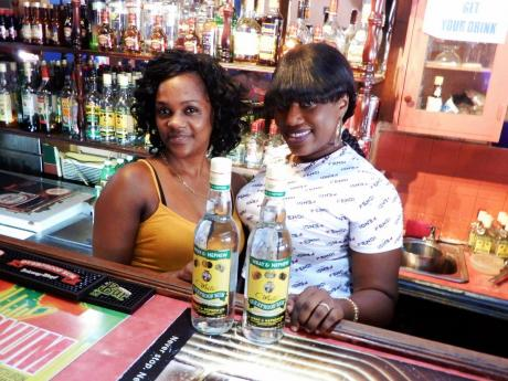 Latoya Lowe (left), owner of  In Dee Go Sports Bar, and bartender Denise.