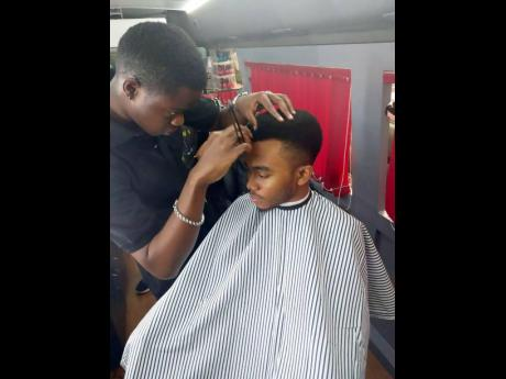 A client gets his hair done at Vanity Squad.