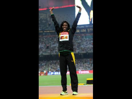 Williams stood atop the podium at the 2015 World Championships after winning the 100 metre hurdles.