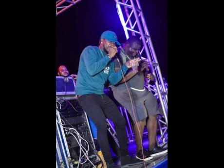 Recording artiste Navino (left) performs alongside birthday boy Animal.