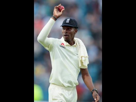 Archer celebrates after taking six wickets on the first day of the third Ashes Test cricket match between England and Australia.