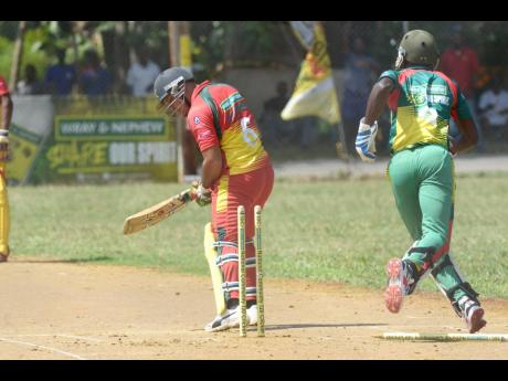 Ramon Davidson of Junction Ballards Valley is bowled by Jevaugh Hinds of Gayle Cricket Club at the Three Hills Oval in St Mary in the SDC Wray & Nephew National Community T20 competition on July 21, 2019.