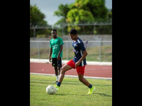 Duncan McKenzie takes part in a training session with the Jamaica College Manning Cup team on September 5, 2019.