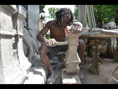 Earl Jackson has been a stonemason for more than 20 years. He currently operates in Waterhouse, St Andrew, and attracts customers from all over the island.