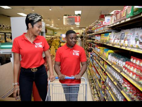 Shorn Hector Dancehall artiste D'Angel and her son, Marco Dean, went Christmas shopping. But it was not about them. Marco Dean, who is the son of superstar Beenie Man, decided he was going to make the Christmas merry for Earl, a less fortunate man who he sees often in the Barbican area of St Andrew.