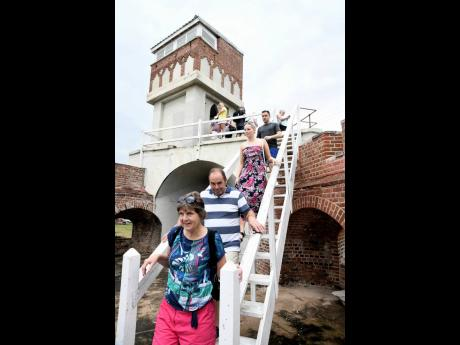Tourists view the sites in Fort Charles after arriving on the Marella Discovery 2.
