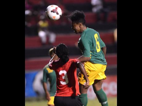 In this October 2013 file photo, Trinidad and Tobago's Subrina Henry looks on as Jamaica's Oshay Lawes (right) beats Trinidad and Tobago's Subrina Henry to a header in their Caribbean Football Union Women's Under-20 final at the Anthony Spaulding Sports Complex in Kingston.
