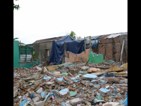 This tarpaulin and these broken walls make up Richardson's home for the moment.