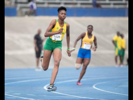 St Jago's Joanne Reid competes the 200m Class One girls event at the S W Isaac Henry Invitational held at the National Stadium last Saturday.