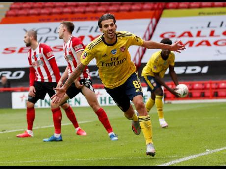 Inset: Arsenal's Dani Ceballos (front) celebrates after scoring his side's second goal during the FA Cup sixth-round match against Sheffield United at Bramall Lane in Sheffield, England, on Sunday.